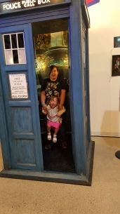 Madi and Molly in the Tardis at Meow Wolf