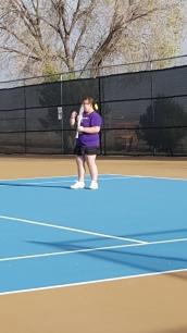Madi playing tennis