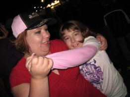 Madi and I at a Toby Keith concert. She used to love to dance with me.