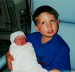 Drew holding Madi the day she was born.